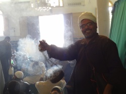 One of the men holding Bukhoor, a sweet fragrance, in a gathering at Ibn Ata' Illah As-Sakandari's Mosque