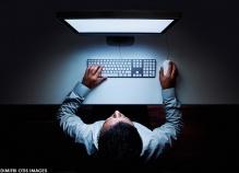 man-computer-top-view-night